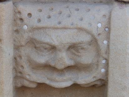 Worn stone face