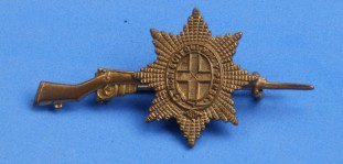 Coldstream Guards sweetheart brooch on rifle
