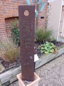Garden sculpture - rusty steel with words cut into it. Yours for £550.