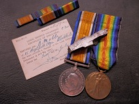 Medals, card and shell splinter