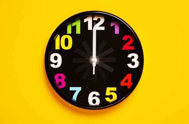 black and yellow analog clock